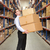 man carrying boxes in warehouse stock photo © monkey_business
