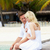 couple sitting on wooden jetty stock photo © monkey_business