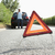 driver broken down on country road with hazard warning sign in f stock photo © monkey_business