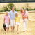 family walking together through summer harvested field stock photo © monkey_business