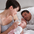 mother feeding newborn baby in bed at home stock photo © monkey_business