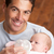 Portrait Of Father Feeding Newborn Baby At Home stock photo © monkey_business