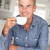 mid age man with coffee at home stock photo © monkey_business