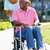 senior woman pushing husband in wheelchair stock photo © monkey_business