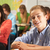 portrait of male pupil studying at desk in classroom stock photo © monkey_business