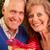 senior couple exchanging christmas gifts stock photo © monkey_business