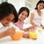 children having breakfast with mother before school stock photo © monkey_business