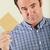 studio shot of middle aged man holding wage packet stock photo © monkey_business