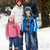 Family Walking Along Snowy Street In Ski Resort stock photo © monkey_business