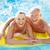 senior · homem · inflável · colchão · praia · verão - foto stock © monkey_business
