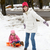 Mother Pulling Daughter On Sledge Along Snowy Street In Ski Reso stock photo © monkey_business