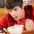 teenage boy teenage texting whilst eating breakfast stock photo © monkey_business