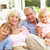 portrait of grandparents with grandchildren relaxing together on stock photo © monkey_business