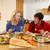 Teenage Family Eating Lunch Together In Kitchen stock photo © monkey_business
