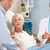 doctor talking to senior couple on ward stock photo © monkey_business