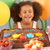young girl with birthday cake and gifts at party stock photo © monkey_business