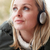 woman wearing headphones and listening to music wearing winter c stock photo © monkey_business