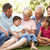 extended group portrait of family enjoying day in park stock photo © monkey_business
