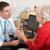 british gp talking to senior woman in surgery stock photo © monkey_business