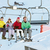 teenage family getting off chair lift on ski holiday in mountain stock photo © monkey_business