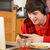 teenage boy using laptop and listening to mp3 player whilst eati stock photo © monkey_business