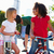 two girls riding tricycles in playground stock photo © monkey_business