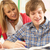 male teenage student studying in classroom with teacher stock photo © monkey_business