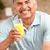 retrato · homem · sorridente · café · da · manhã - foto stock © monkey_business