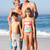 grandparents and grandchildren standing on sandy beach stock photo © monkey_business