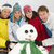 group of friends building snowman on ski holiday in mountains stock photo © monkey_business