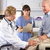 doctor examining male patient with knee pain stock photo © monkey_business