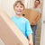 boy with young man on moving day carrying cardboard box stock photo © monkey_business