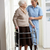 carer helping elderly senior woman using walking frame stock photo © monkey_business