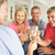 mid age couples drinking together at home stock photo © monkey_business