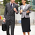businessman and businesswoman walking along street holding takea stock photo © monkey_business