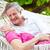 senior couple relaxing in beach hammock stock photo © monkey_business