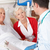doctor talking to senior couple on uk hospital ward stock photo © monkey_business