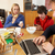 teenage family using gadgets whilst eating breakfast together in stock photo © monkey_business
