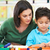 elementary pupil counting with teacher in classroom stock photo © monkey_business