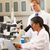 male and female scientists using microscopes in laboratory stock photo © monkey_business
