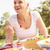 senior woman enjoying meal in garden stock photo © monkey_business