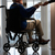 disabled senior man sitting in wheelchair being handed cup stock photo © monkey_business