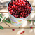 ripe fresh cherries in a colored bucket and ripe cherries with leaves outdoor stock photo © moravska