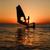 silhouet · zon · zonsondergang · zee · hemel · man - stockfoto © mrakor