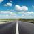 black asphalt road to horizon under deep blue cloudy sky stock photo © mycola