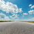 asphalt road to horizon and clouds over it stock photo © mycola