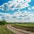winding rural road to cloudy horizon stock photo © mycola