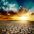global warming dramatic sunset over cracked earth stock photo © mycola