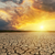 cracked desert closeup and dramatic sunset over it stock photo © mycola