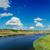 kék · ég · napsugarak · ragyogó · mögött · felhők · égbolt - stock fotó © mycola
